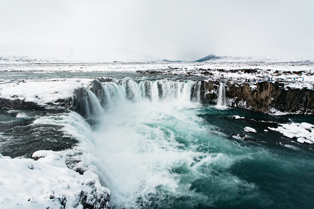 Godafoss waterfall in during winter with snow and ice covered landscape