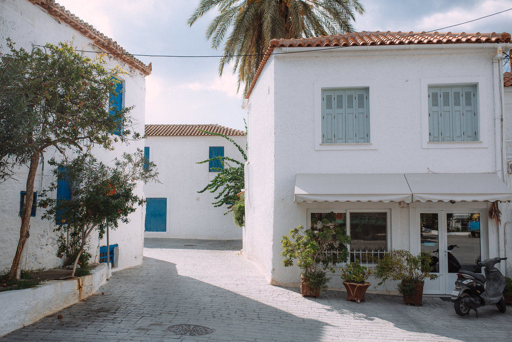 White buildings in the port town of Ermioni, an island in greece