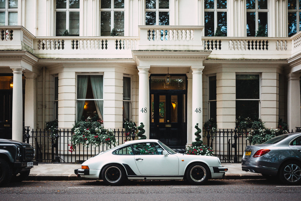 White Porsche 911 in front of luxury west london house