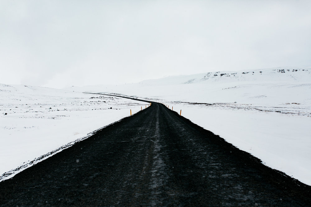 road in iceland with snow covered landscape