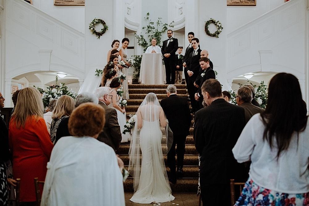 44-bride-and-dad-walk-through-guests.jpg