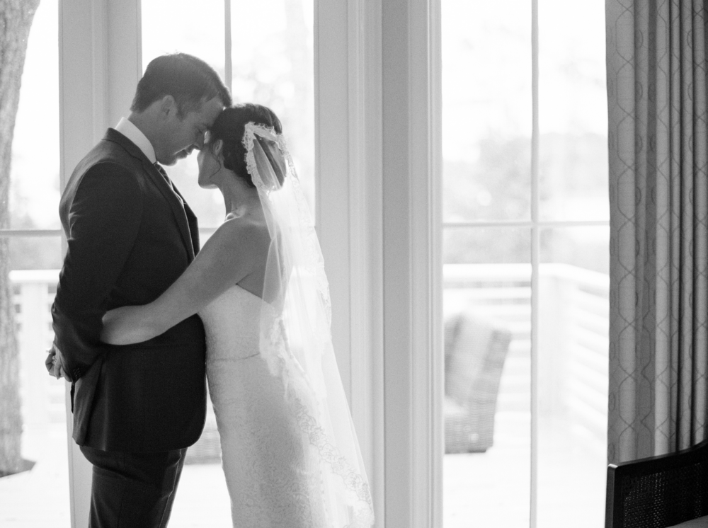 bride_and_groom_embrace_black_and_white_portrait_west_palm_wedding_photographer_shannon_griffin.png