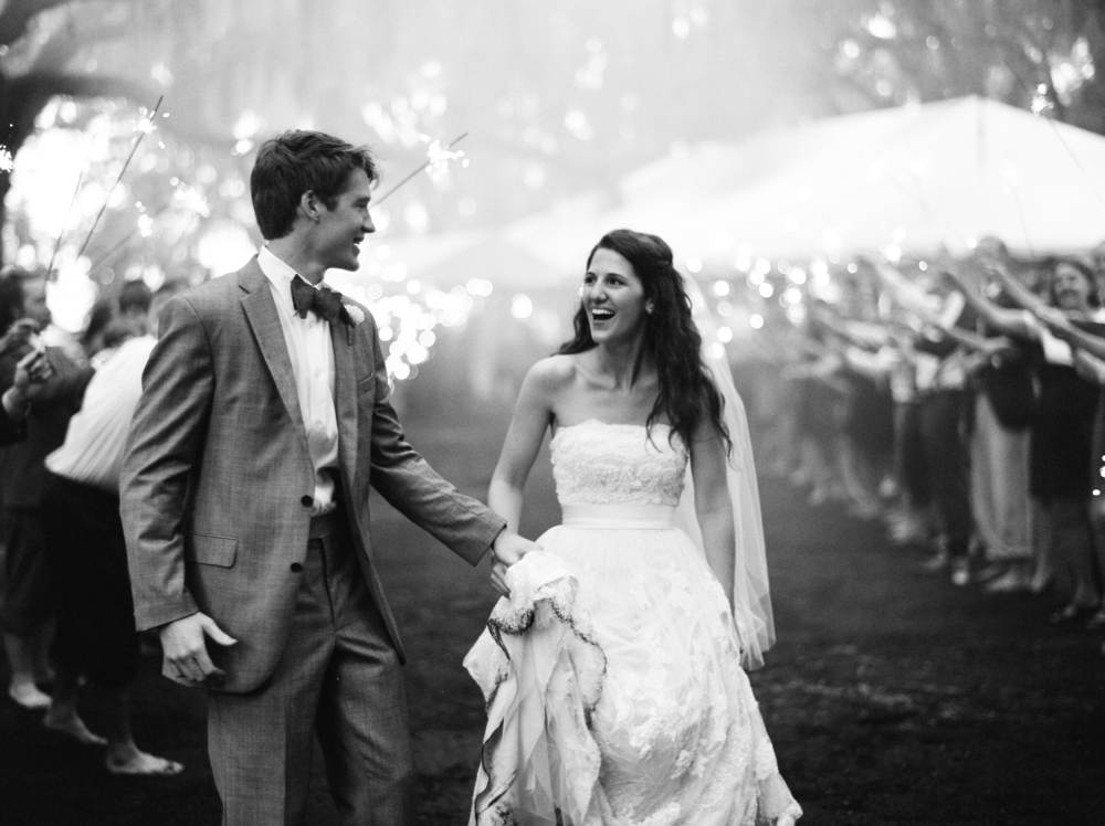 bride_and_groom_running_sparkler_exit_west_palm_wedding_photographer_shannon_griffin.png