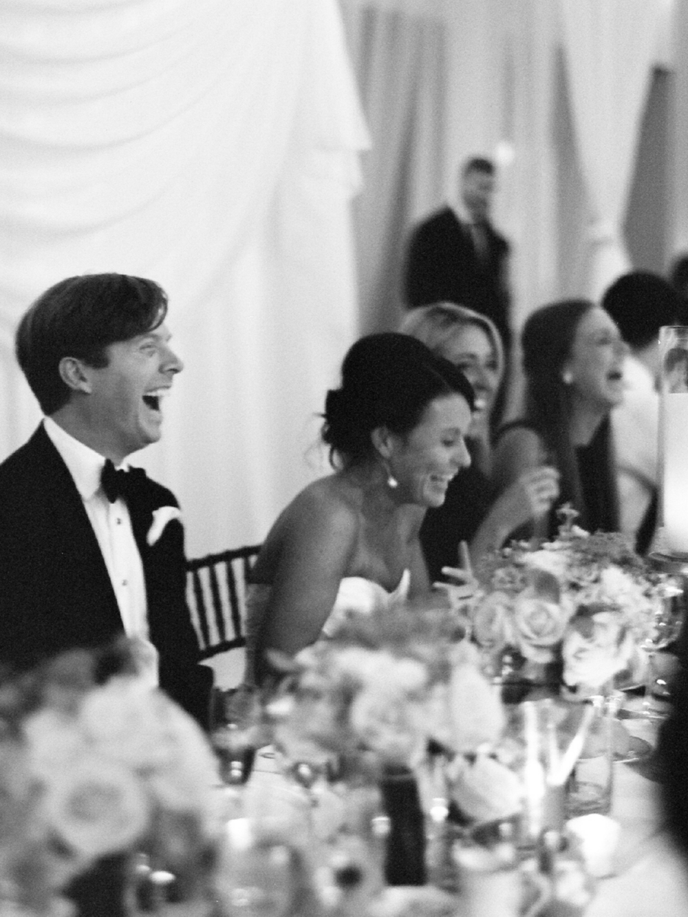 bride_laughint_during_toast_west_palm_wedding_photographer_shannon_griffin.png