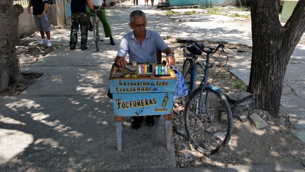 One of several cigarette lighter repairmen in Holguin, Cuba