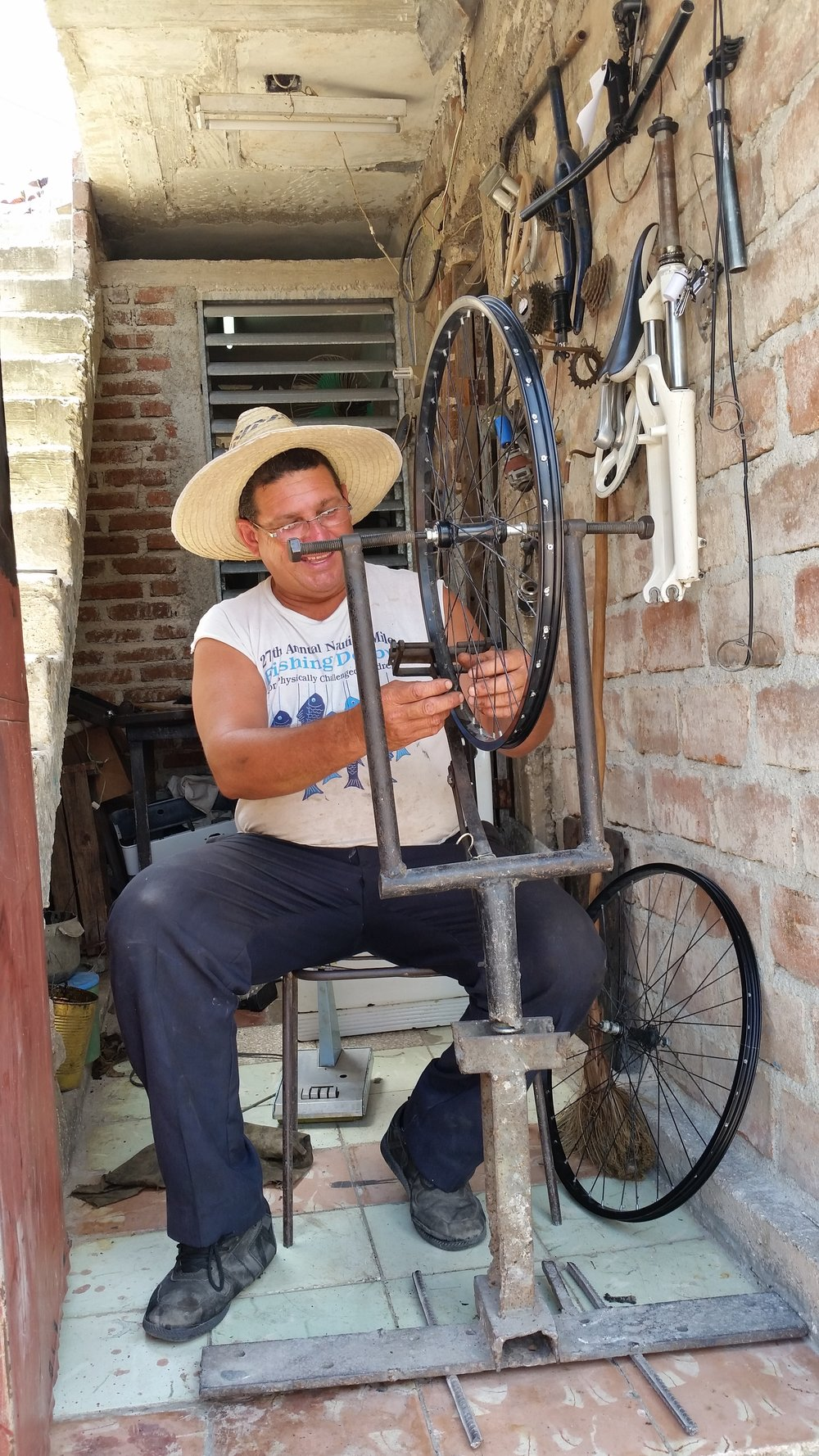 The owner of a small bike shop in Holguin, Cuba.