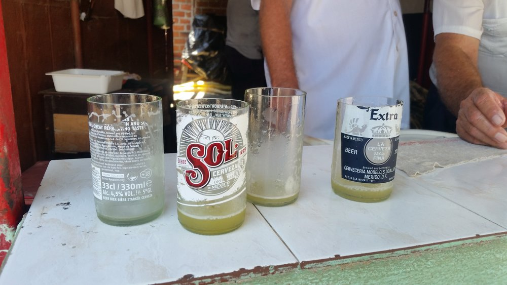 """Sawed-off beer bottles now serve as """"guarapo"""" (fresh sugar cane juice) glasses in Bayamo, Cuba"""
