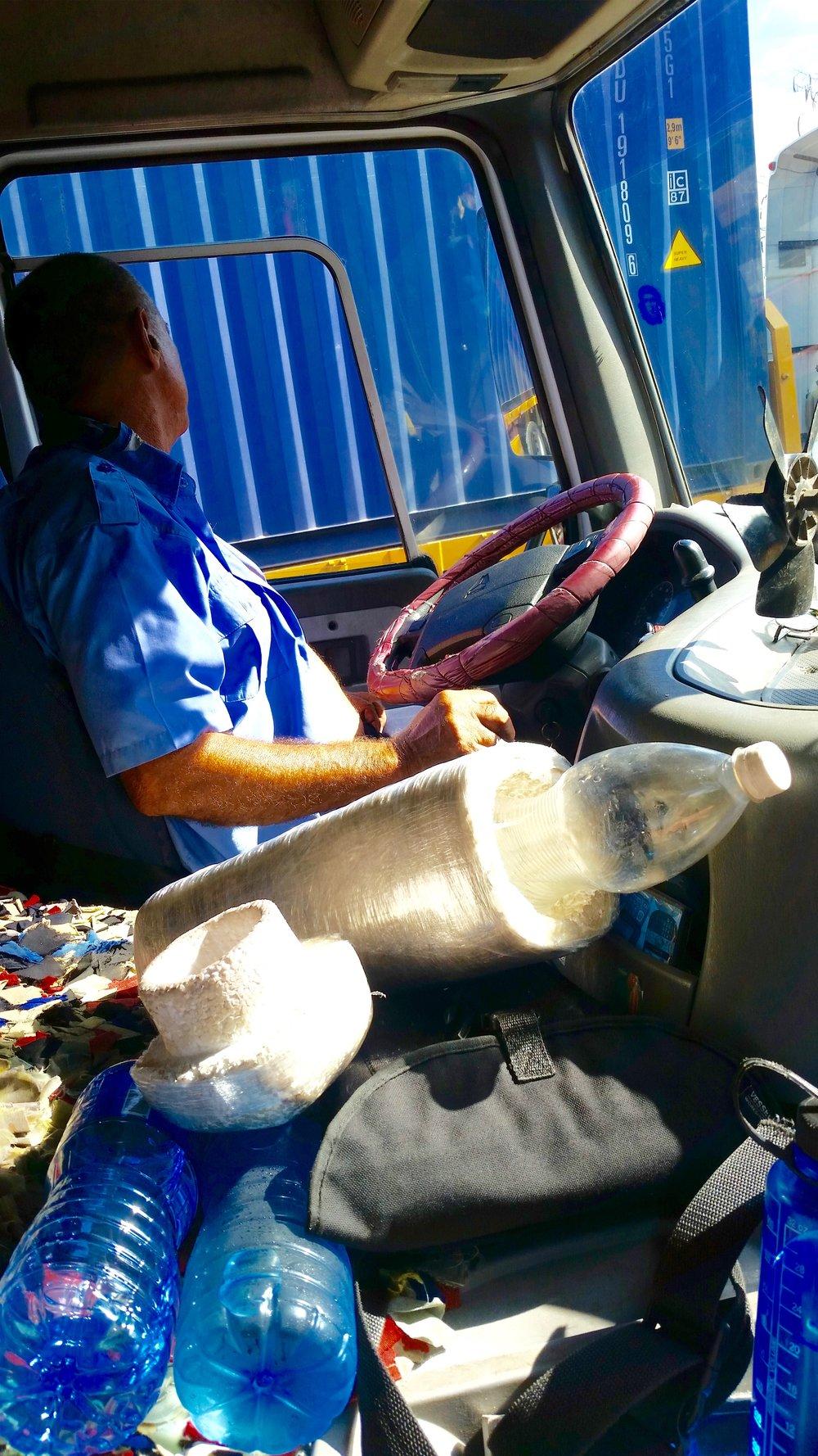 A trucker's homemade water bottle cooler keeps him refreshed from Santa Clara to Jaguey Grande, Matanzas