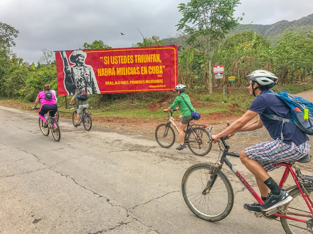 Biking through Vinales countryside to go zip-lining