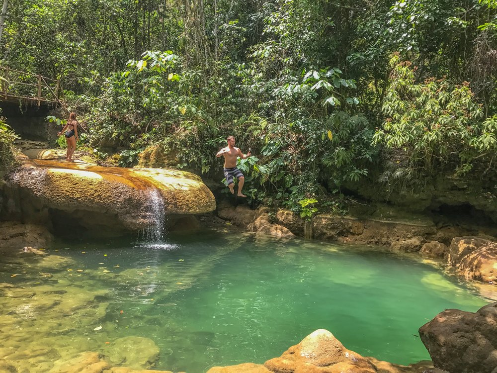 Jumping into a swimming hole in El Nicho, Cienfuegos.