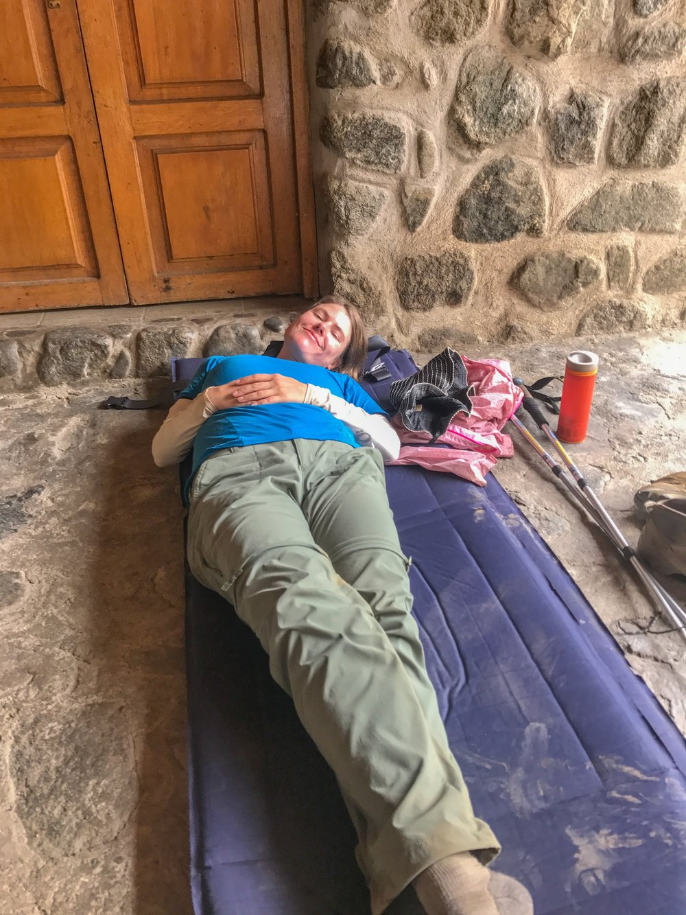 A checkpoint officer took pity on my cold and lent me his sleeping mat to take a nap