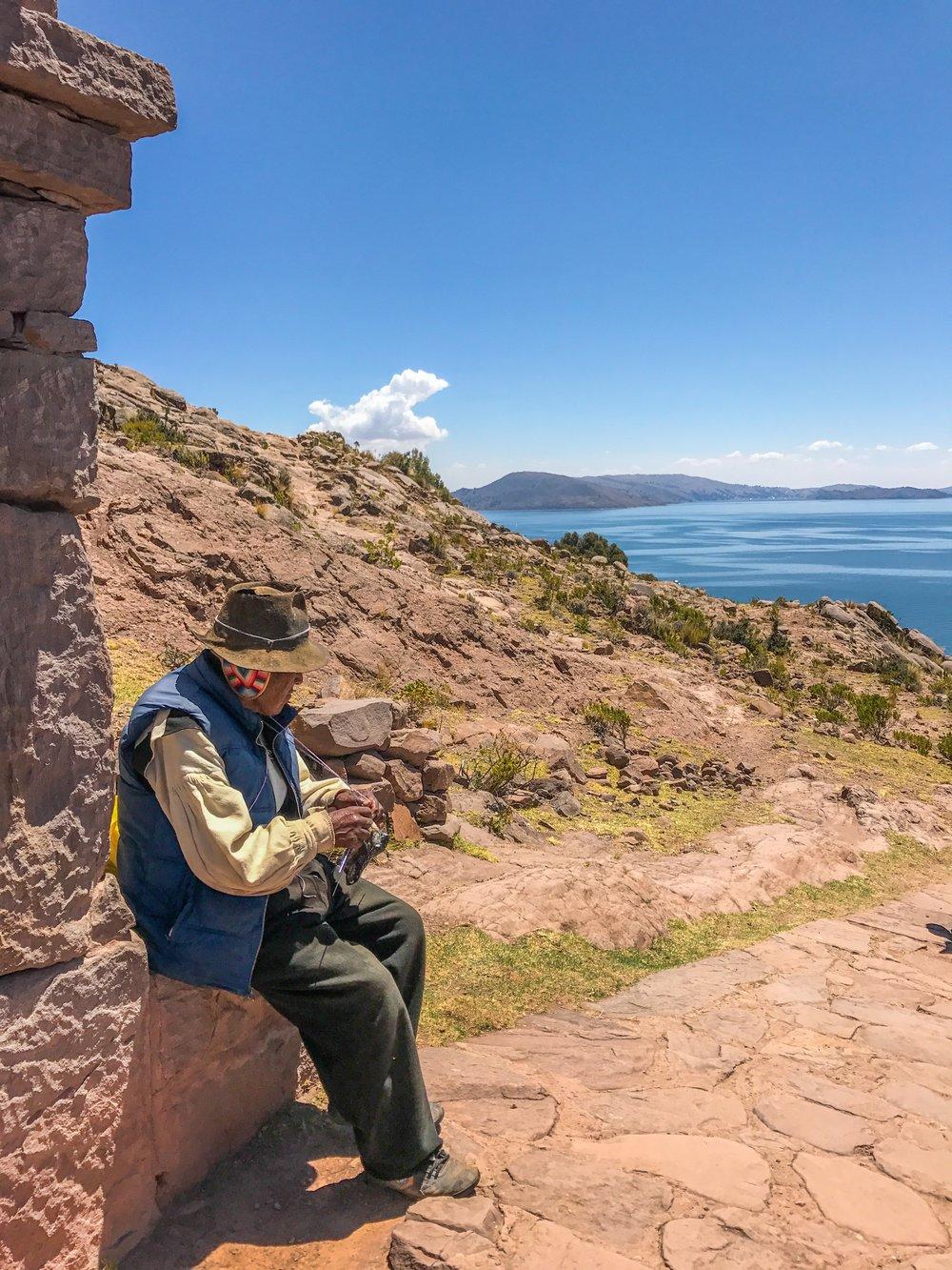 An elder Taquile man knitting