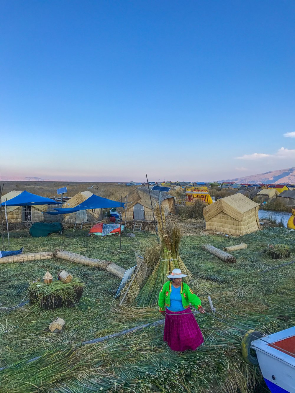 An Uros woman welcomes us to her island