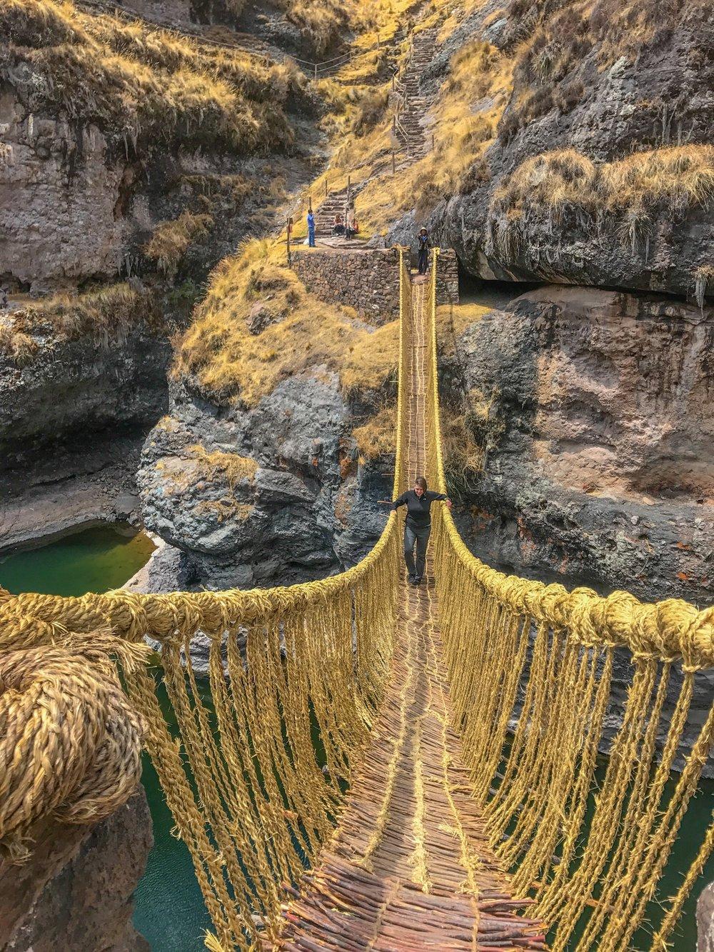 Crossing the last Inca reed bridge in Peru