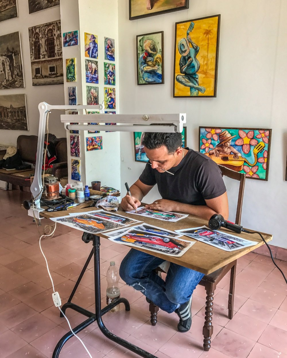 Visiting a painter in his studio in Cienfuegos