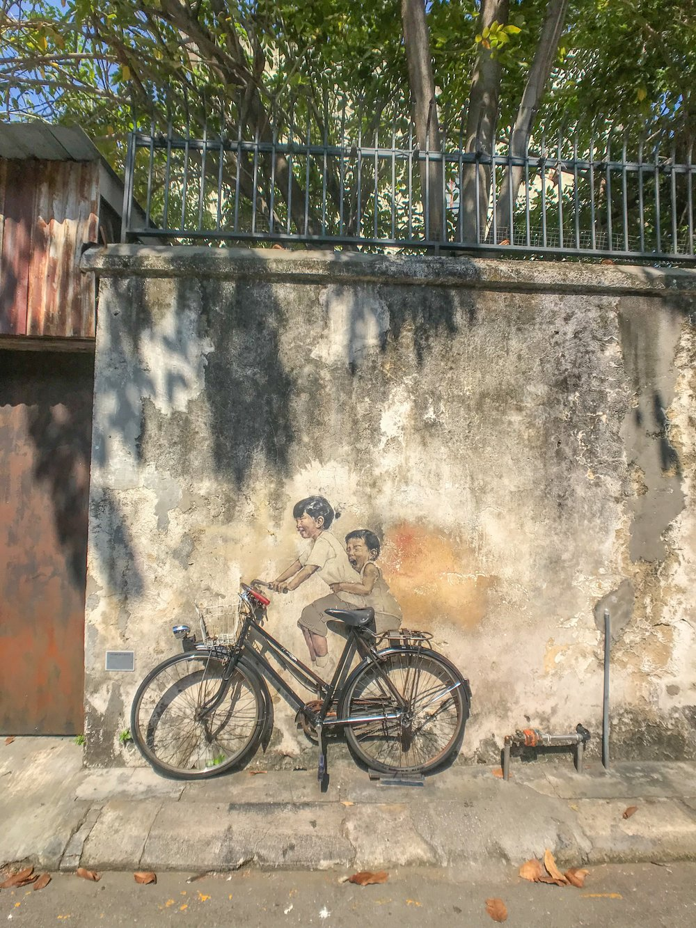 "Penang's famous ""kids on a bicycle"" street art"