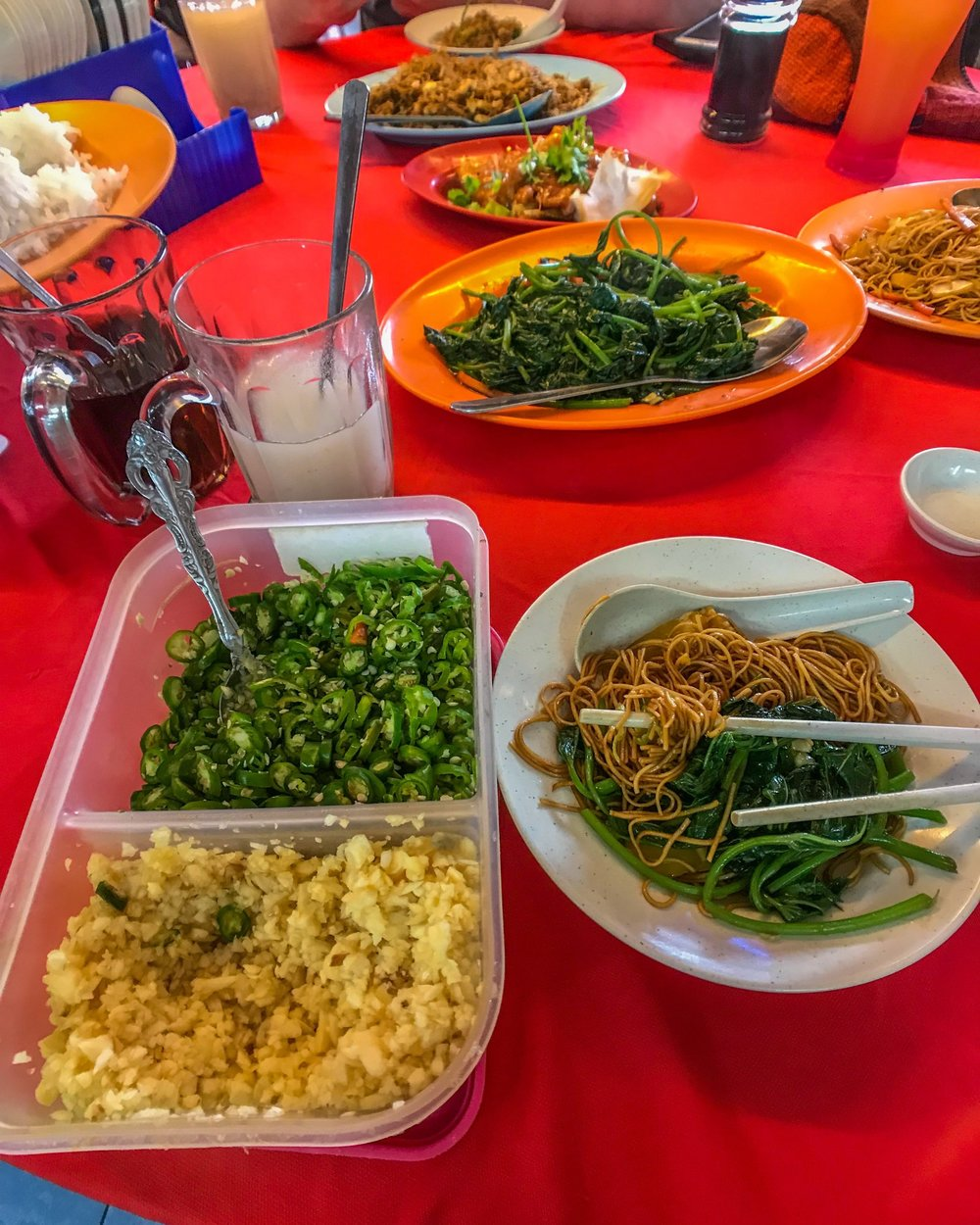 Chinese pea shoots and noodles served with plenty of garlic and chili in the Cameron Highlands