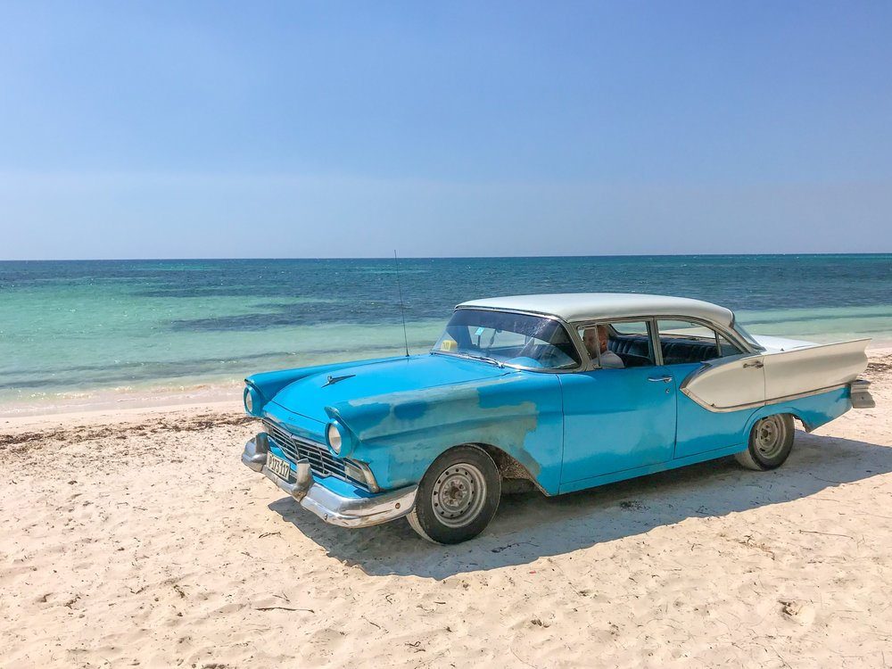 Classic cars on the beach in Vinales