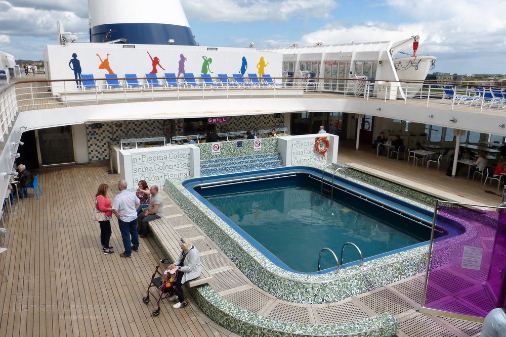 Silhouettes of colorful people adorn the base of the funnel and Spanish words can be seen on the decorative tiles at the back of the pool. Holdovers from Magellan's time with Ibero Cruises.