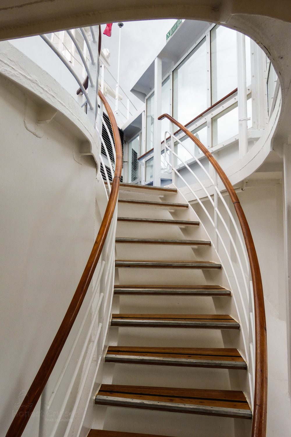 Beautifully curved stairs leading from Marquee deck 9, just aft of The Observatory lounge, leading up Sun deck 10.