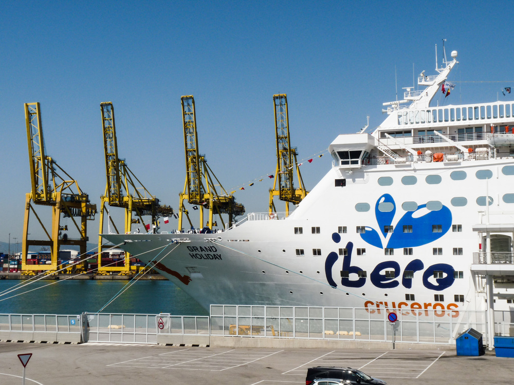Magellen as Grand Holiday for Ibero Cruises. Notice the orange silhouette on the tip bow seeming to jump ship.