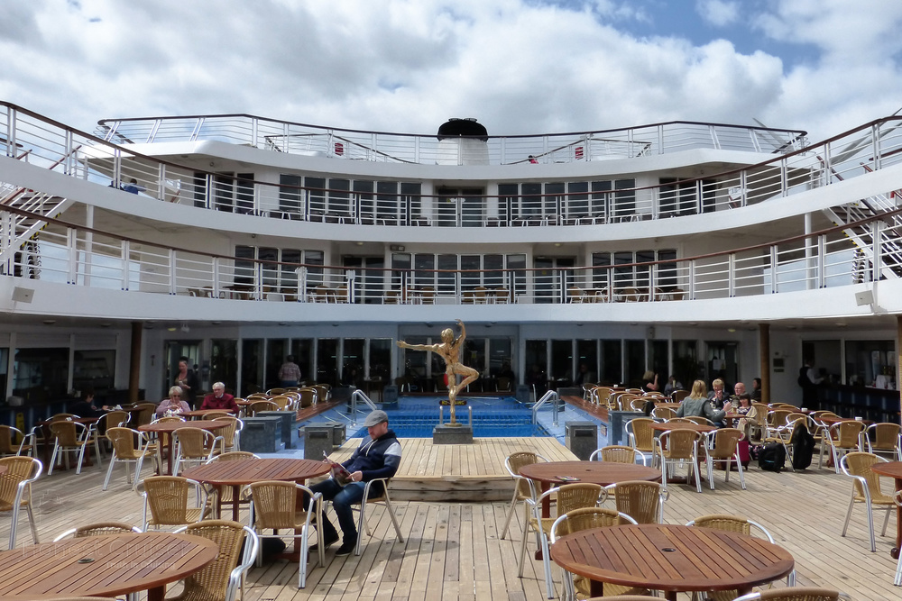 The beautiful stern of Marco Polo wrapping around her pool on Magellan deck 8.
