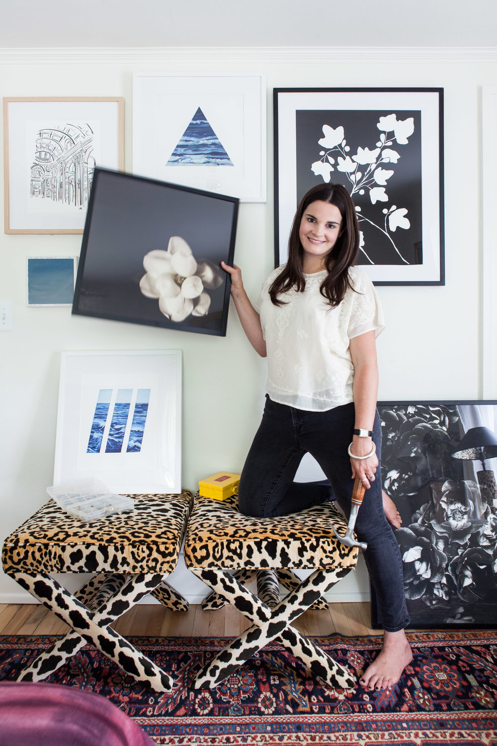 Michelle at home with a collection of pieces from Artfully Walls. Photo by Marta Xochilt Perez.