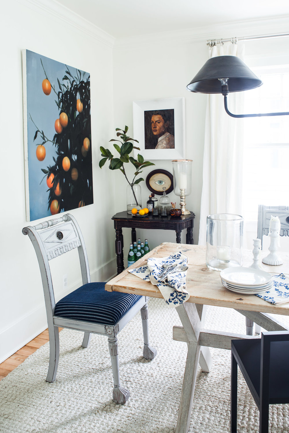 A few of Michelle's all-time favorite pieces hang in her dining room. Photo by Marta Xochilt Perez