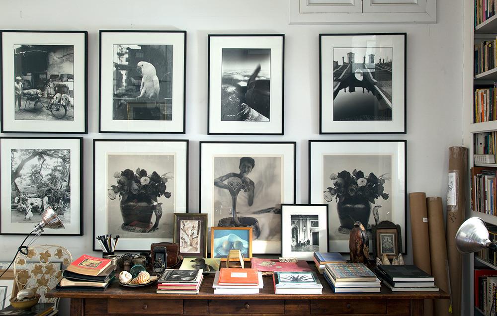 Inside the West Village home of Joy Sohn and Oberto Gili,framed photos from Gili's trips to Sri Lanka, Hong Kong, and Comacchio, Italy, line the walls. Photo by Joy Sohn via Domino.