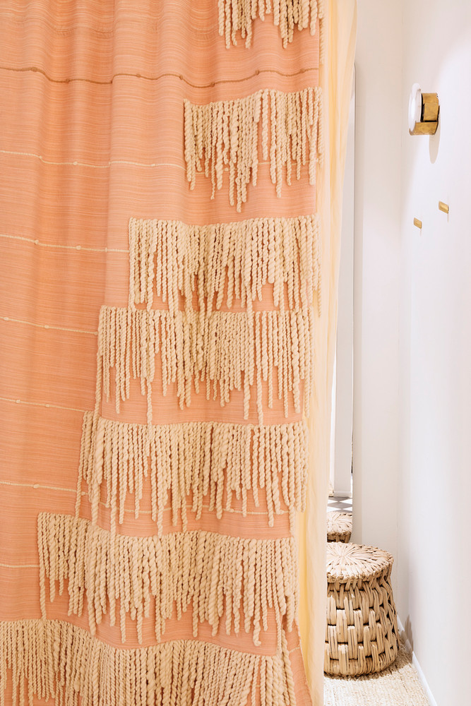 this-new-boutique-for-stylish-mamas-to-be-feels-like-the-ultimate-nest-orange-and-pink-and-white-vignette-5a3a9b86604f27084a0d3823-w1000_h1000.jpg