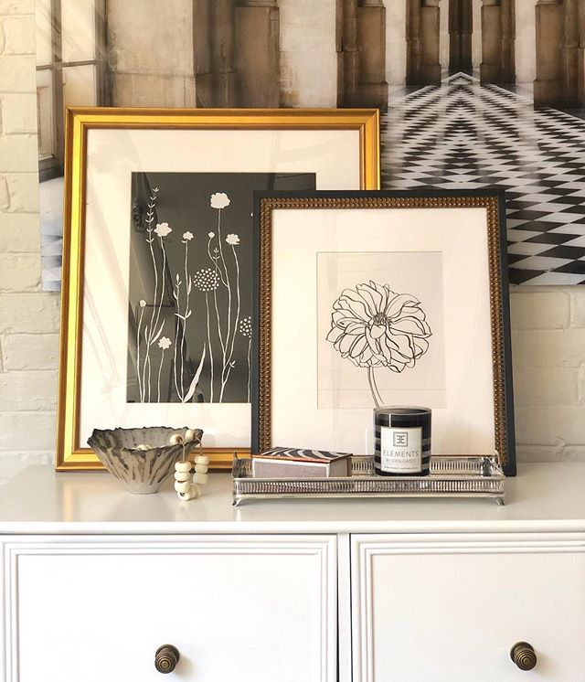 We love layering art, and this gorgeous vignette by @elementstyle shows why.  Art included: Flowers for Everly by Rob Blackard and Dahlia by Megan Williamson