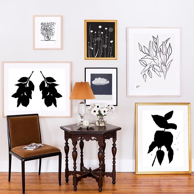 We're big fans of black and white - it's classic, and so versatile. Here, black and white art is paired with simple frames, and is juxtaposed with traditional furniture for the perfect balance.  Clockwise from top: Flowers for Everly by Rob Blackard, Lilies by Lynne Millar, Long Branch by Kate Roebuck, Storm Cloud by Sara Beckley and Laura Else, Lemon Branches by Kate Roebuck, Mixed Bouquet by Liz Innvar  Styled by @michelle_adams_ and @emily.a.schoen  Photo by @martaxperez