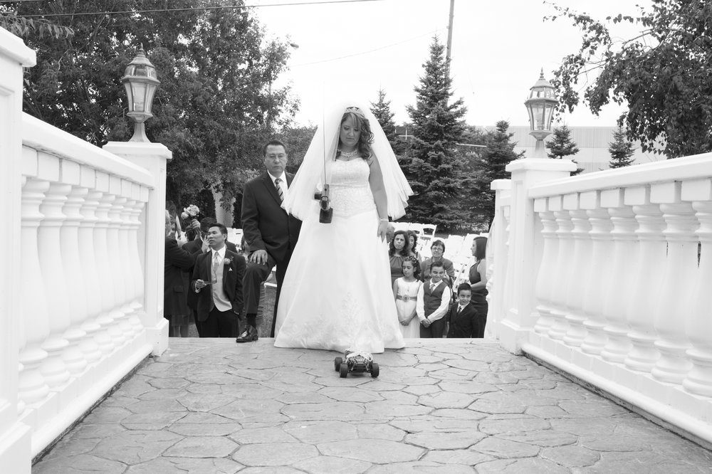 Bride on white italian style bridge 1st look Toronto