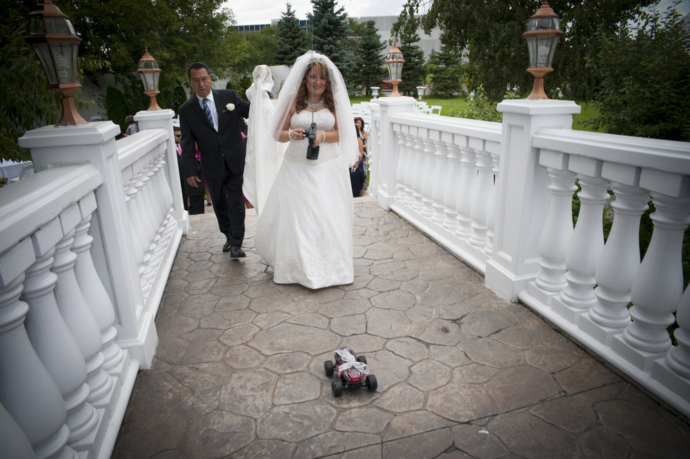 Paradise wedding bride with remote controlled car
