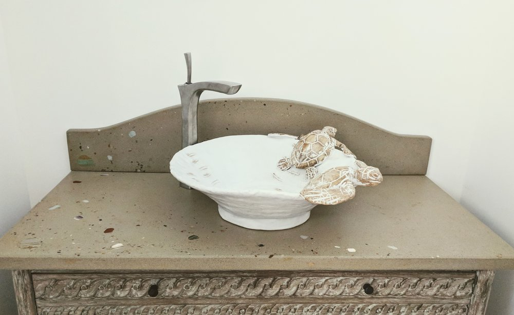 Beach Inspired Concrete Vanity top with seaglass, beach sand and seashell embedments - Design by Urban Cottage