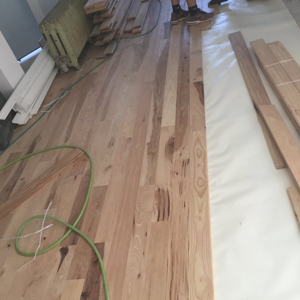 Hickory floors cost more but they're 40% harder than oak and owners love them.