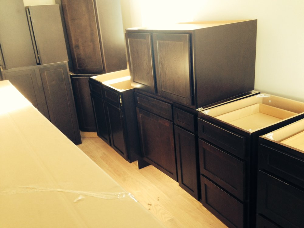 We installed gorgeous dark wood cabinets in the kitchen.