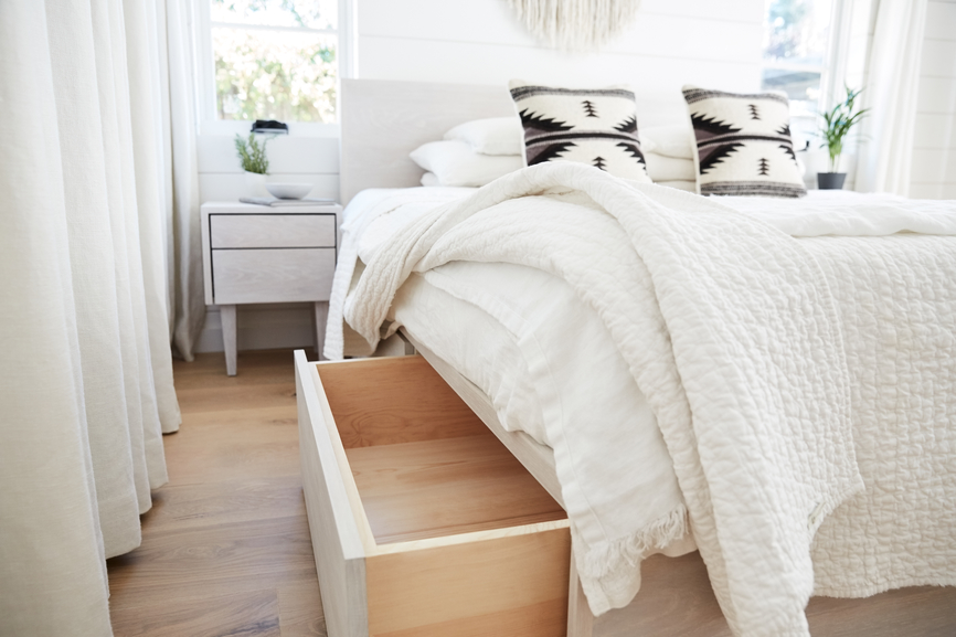 A custom queen bed with pull out drawers underneath for hidden storage.