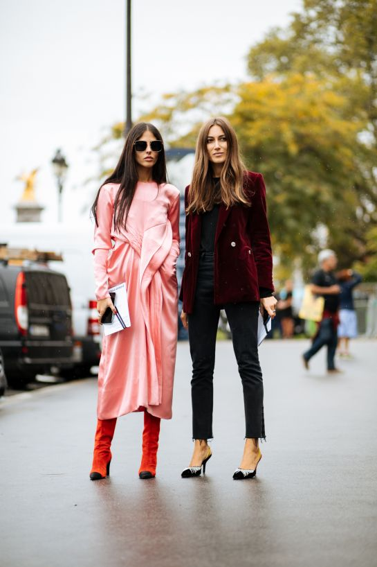 Gilda Ambrosio wears a Céline dress with Chanel boots while her Attico co-founder Giorgia Tordini pairs her burgundy velvet jacket with jeans and point-toe heels.