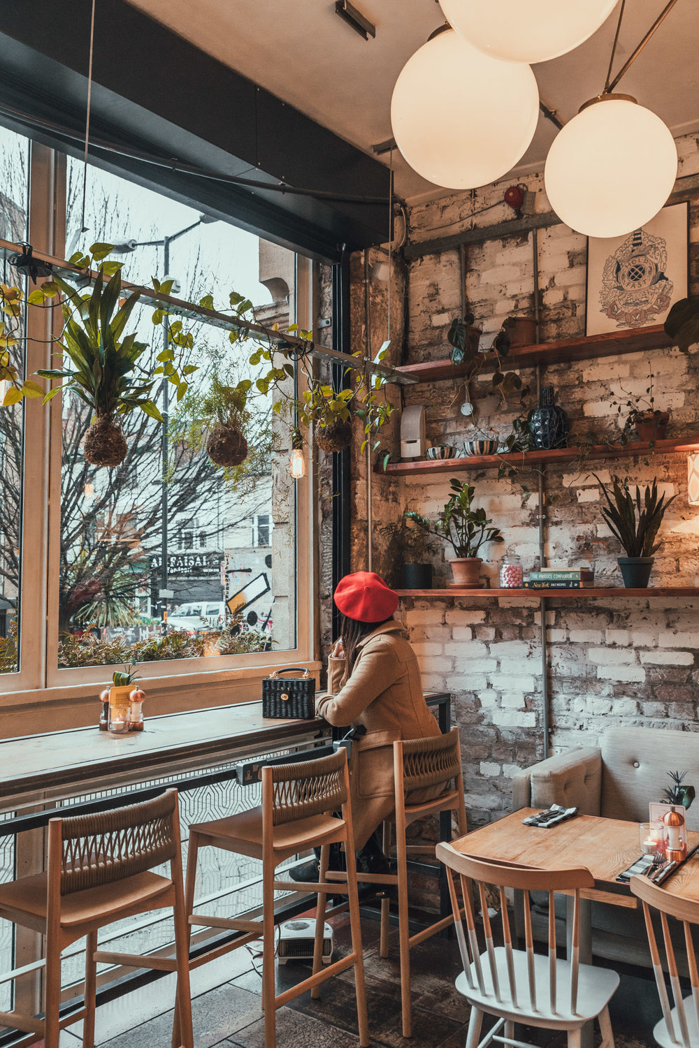 The succulent-filled interior of Evelyn's Cafe Bar in Manchester // 11 INSTAGRAM-WORTHY PHOTO SPOTS IN MANCHESTER, ENGLAND // www.readysetjetset.net #readysetjetset #manchester #england #uk #unitedkingdom #cityguide #travel