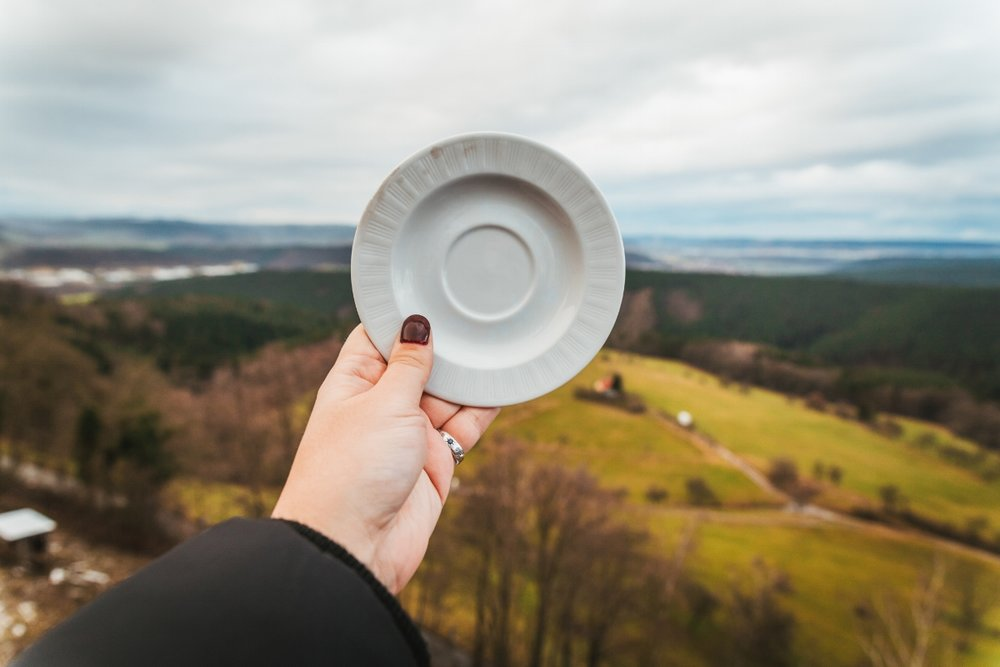 Smashing porcelain plates at Leuchtenberg Castle Christmas Market // German Christmas Markets and Beyond: A Trip to Thuringia in December
