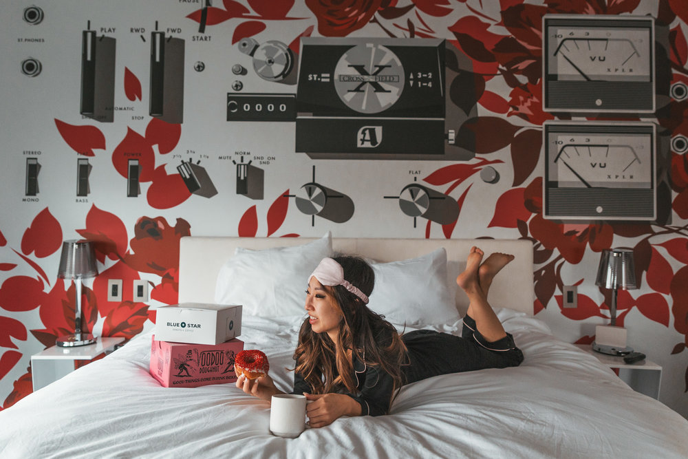 Donuts in bed at the hotel // Checking In: The Radisson Red in Downtown Portland, Oregon #readysetjetset #pdx #portland #blogpost #travelguide