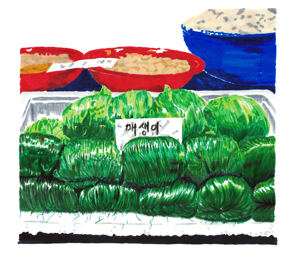 Bundles of  maesaengi,  a delicate seaweed farmed in South Korea, for sale at a seafood market.