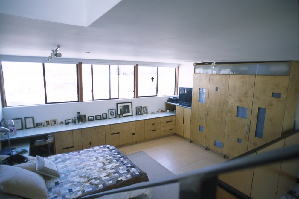 This cabinetry installation was designed for one of the occupants of the Electric Avenue Artist's Lofts who desired to personalize her unit by providing substantial closet space.