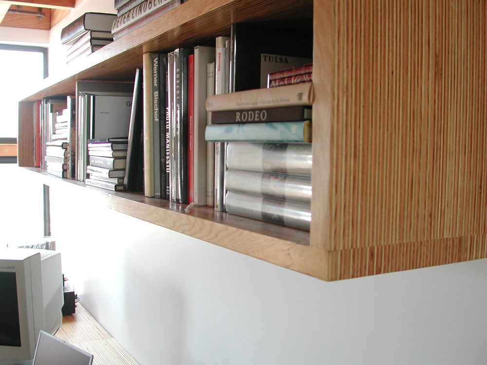 A detail of the bookshelf, showing the continued use of the plywood endgrain motif.