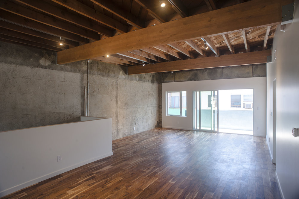 Renovated apartment with raised ceilings looking out towards new balcony.