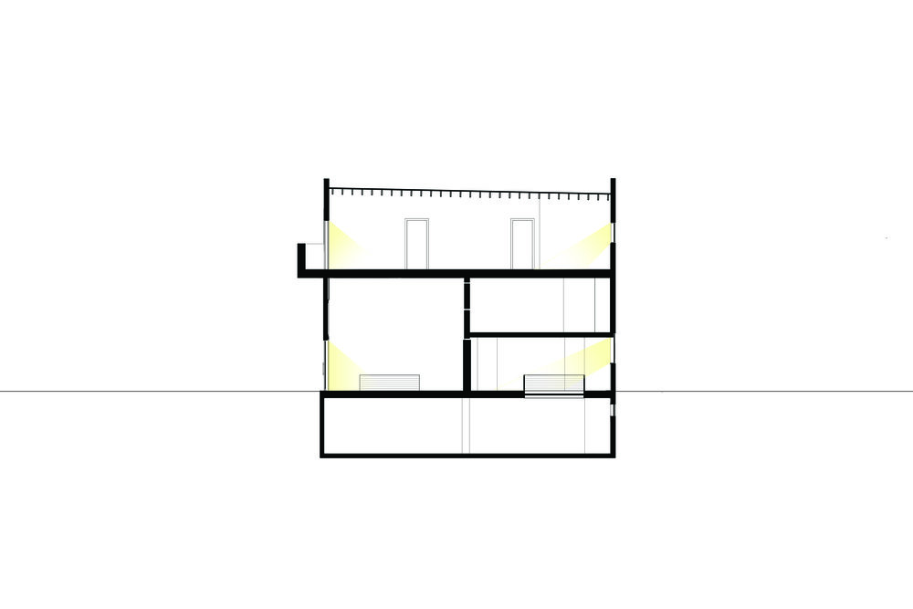 Section through reconfigured building with second floor apartment with raised ceilings and new balcony, mezzanine bedroom and gallery subdivided with operable walls, with basement skylights integrating basement living space.