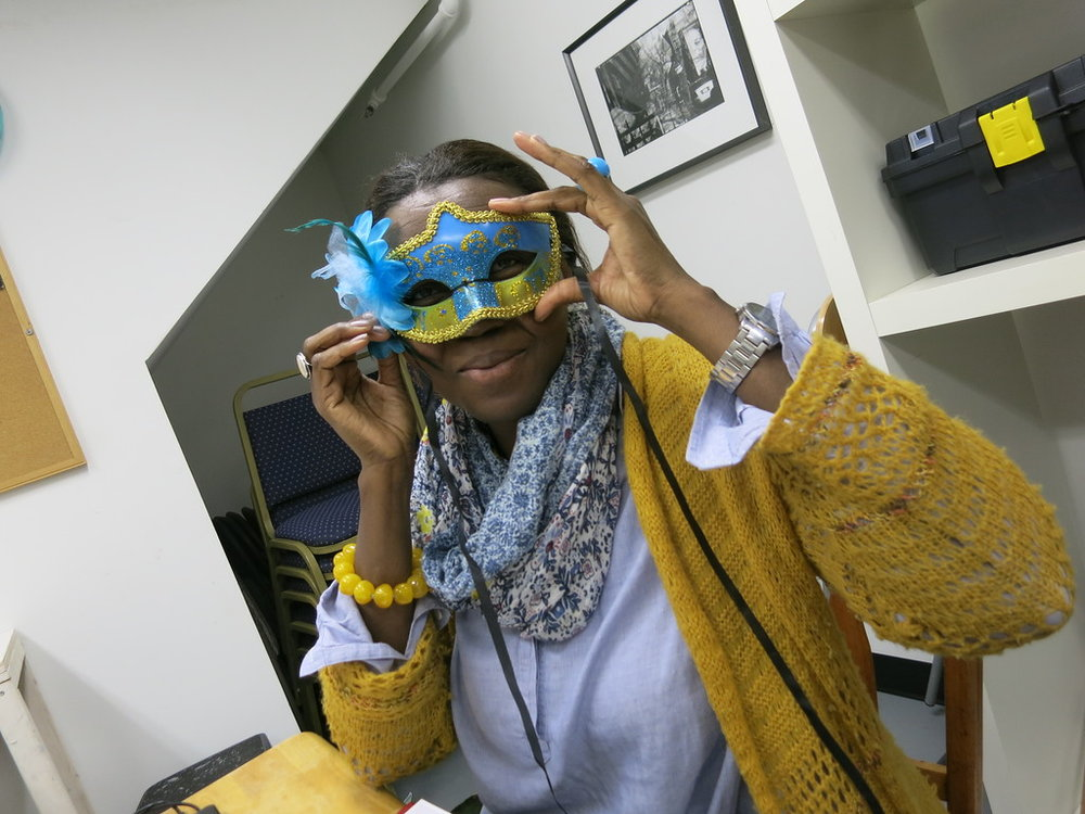 Colette in a colorful mask, typically worn for Ghede celebrations in Haiti.