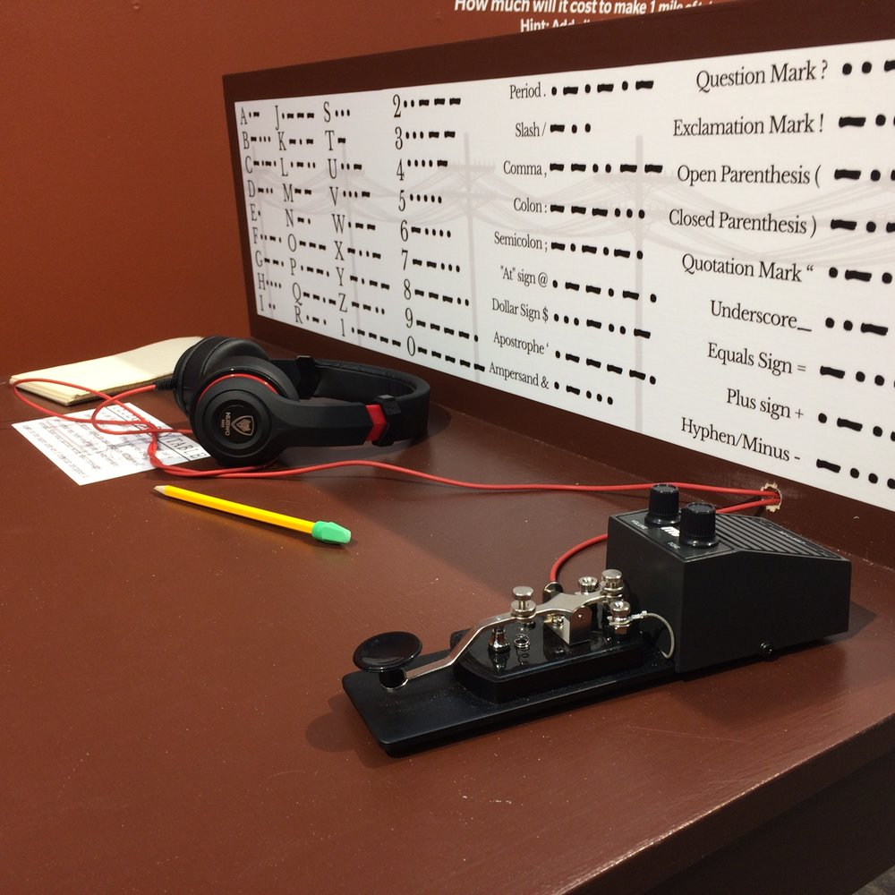 Guests can send Morse code messages with one another at the Telegraphy table.