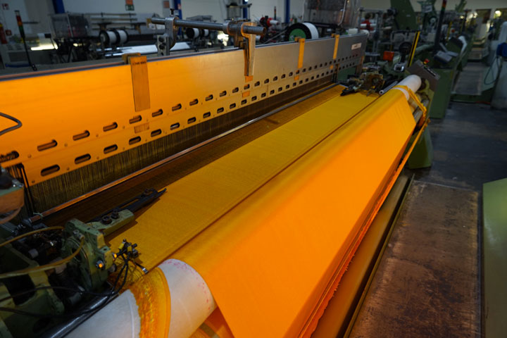 At the textile manufacturer Setex, 90,000 square meters of shimmering yellow fabric are produced